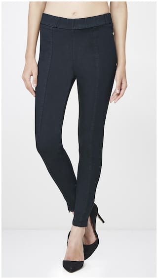 AND Women Regular Fit Mid Rise Solid Jegging - Black