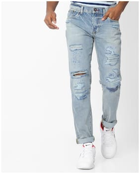 Distressed Low-Rise Tapered Jeans