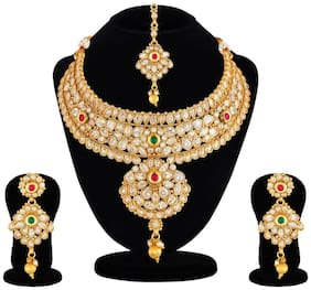 Apara Glittering Kundan Studded Jewellery Set with Pearl and Maang Tikka For Women